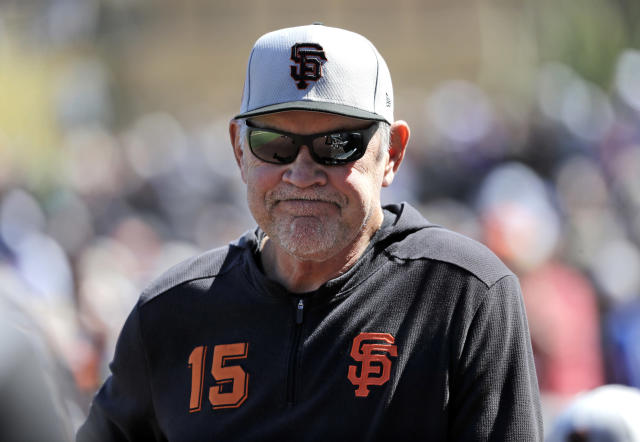 FILE - In this March 14, 2019, file photo, San Francisco Giants manager Bruce Bochy stands on the field before a spring training baseball game against the Arizona Diamondbacks in Scottsdale, Ariz. Bochy has long been a manager who made it about his players, the men he writes into the lineup day after day, month after month. That's a big reason San Francisco's veteran, likely Hall of Fame skipper, decided in February to make it public he will retire at the end of this season. (AP Photo/Elaine Thompson, File)