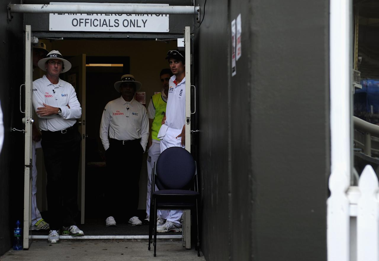 WELLINGTON, NEW ZEALAND - MARCH 17:  England captain Alastair Cook looks from the dressing room during a rain break during day four of the second Test match between New Zealand and England at Basin Reserve on March 17, 2013 in Wellington, New Zealand.  (Photo by Gareth Copley/Getty Images)