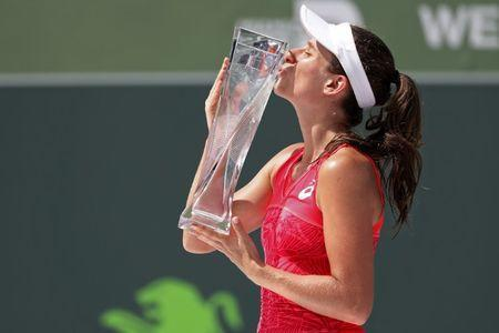 Apr 1, 2017; Key Biscayne, FL, USA; Johanna Konta of Great Britain kisses the Butch Buchholz Trophy after her match against Caroline Wozniacki of Denmark (not pictured) in the women's singles championship of the 2017 Miami Open at Crandon Park Tennis Center. Mandatory Credit: Geoff Burke-USA TODAY Sports