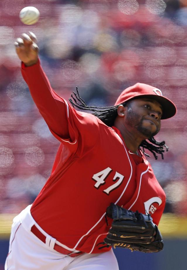 Cincinnati Reds starting pitcher Johnny Cueto throws against the Pittsburgh Pirates in the first inning of a baseball game, Wednesday, April 16, 2014, in Cincinnati. (AP Photo/Al Behrman)