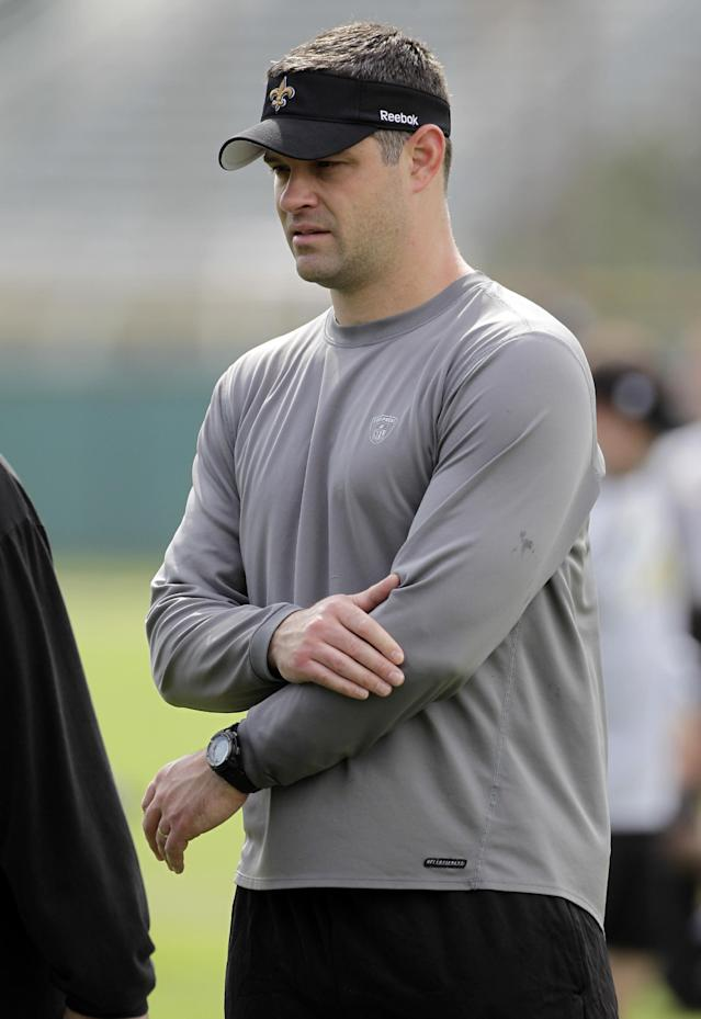 FILE - In this Feb. 5, 2010, file photo, New Orleans Saints quarterbacks coach Joe Lombardi watches during NFL football practice in Miami. A person familiar with the situation says new Detroit Lions head coach Jim Caldwell and Lombardi, the grandson of former Green Bay Packers Hall of Fame coach Vince Lombardi, have agreed on deal for Lombardi to become the Lions' offensive coordinator. The person spoke to The Associated Press on condition of anonymity on Tuesday, Jan. 21, 2014, because the Lions have not announced the hiring, which was first reported by ESPN. (AP Photo/Mark Humphrey, File)