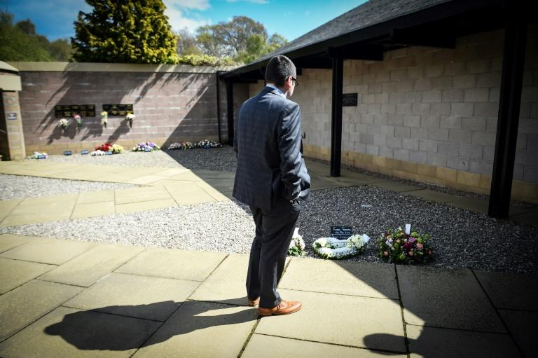 Jamie Livingston spent two weeks in isolation after his mother's death, before attending her funeral service on Monday (AFP Photo/Andy Buchanan)