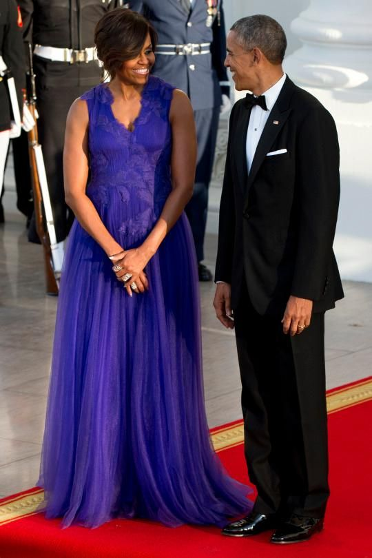 <p>At a state dinner for Japanese Prime Minister Shinzo Abe and his wife Akie Abe, Michelle opted for a Tadashi Shoji dress from the Fall 2015 Ready-to-Wear collection, which featured feathers and a layered tulle skirt.</p>