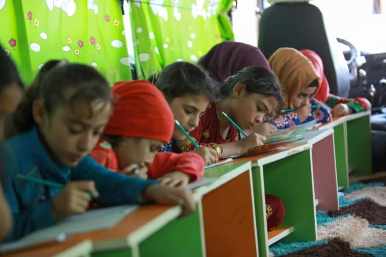 The buses cater only for ages ranging from five to 12 and include classes in Arabic, mathematics, science and sometimes English, as well as singing and drawing (AFP Photo/Aaref WATAD)