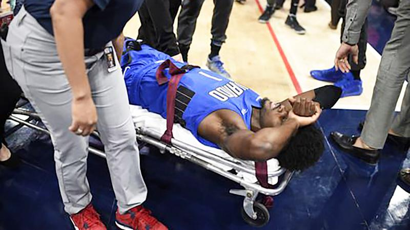 Jonathan Isaac, pictured here being taken from the court on a stretcher.