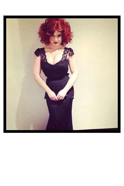 <p>As <em>Mad Men</em> star, Christina Hendricks, with fire-red locks and a vintage lace dress. ‬</p>