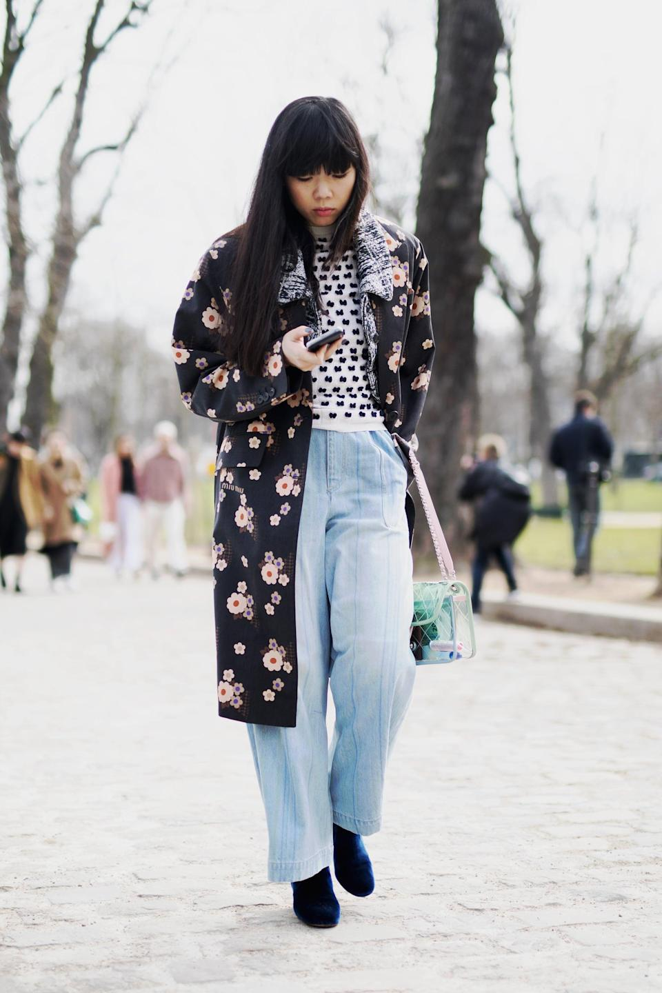 <p>Baggy jeans are the perfect way to offset the sweetness of a floral print. </p>