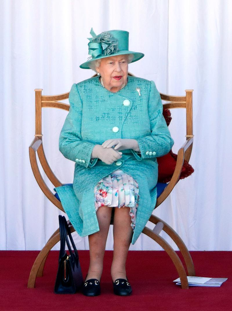 WINDSOR, UNITED KINGDOM - JUNE 13: (EMBARGOED FOR PUBLICATION IN UK NEWSPAPERS UNTIL 24 HOURS AFTER CREATE DATE AND TIME) Queen Elizabeth II attends a military ceremony in the Quadrangle of Windsor Castle to mark her Official Birthday on June 13, 2020 in Windsor, England. It was decided that due to the ongoing COVID-19 Pandemic The Queen's Birthday Parade, known as Trooping the Colour, would not go ahead in it's traditional form at Buckingham Palace and Horse Guards Parade, but a small military ceremony in line with the Government's Social Distancing Guidelines would take place at Windsor Castle instead. Soldiers of 1st Battalion Welsh Guards (whose Colour was due to be Trooped this year) will carry out a series of military drills and Royal Salute. (Photo by Max Mumby/Indigo/Getty Images)