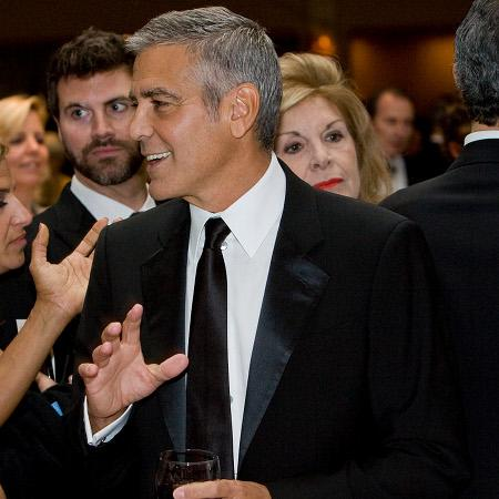 George Clooney 'parties into morning'