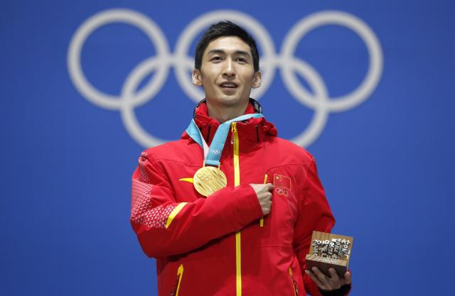 Medals Ceremony - Short Track Speed Skating Events - Pyeongchang 2018 Winter Olympics - Men's 500m - Medals Plaza - Pyeongchang, South Korea - February 23, 2018 - Gold medalist Wu Dajing of China on the podium. REUTERS/Eric Gaillard