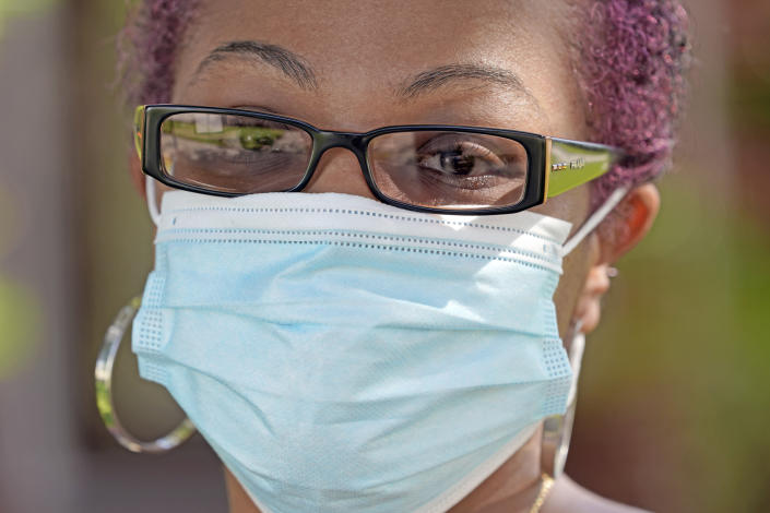 """Parent and teacher Stacey Pugh poses for a photograph outside her home Monday, July 13, 2020, in Humble, Texas. While children have proven to be less susceptible to the coronavirus, teachers are vulnerable. """"I will be wearing a mask, a face shield, possibly gloves, and I'm even considering getting some type of body covering to wear,"""" says Pugh, a fifth-grade teacher in suburban Houston. (AP Photo/David J. Phillip)"""