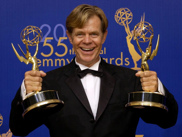 "William H. Macy holds his two awards for outstanding lead actor in a movie and outstanding writing in a movie for his work in ""Door to Door"" at the 55th annual Primetime Emmy Awards Sunday, Sept. 21, 2003, in Los Angeles. (AP Photos/Reed Saxon)"