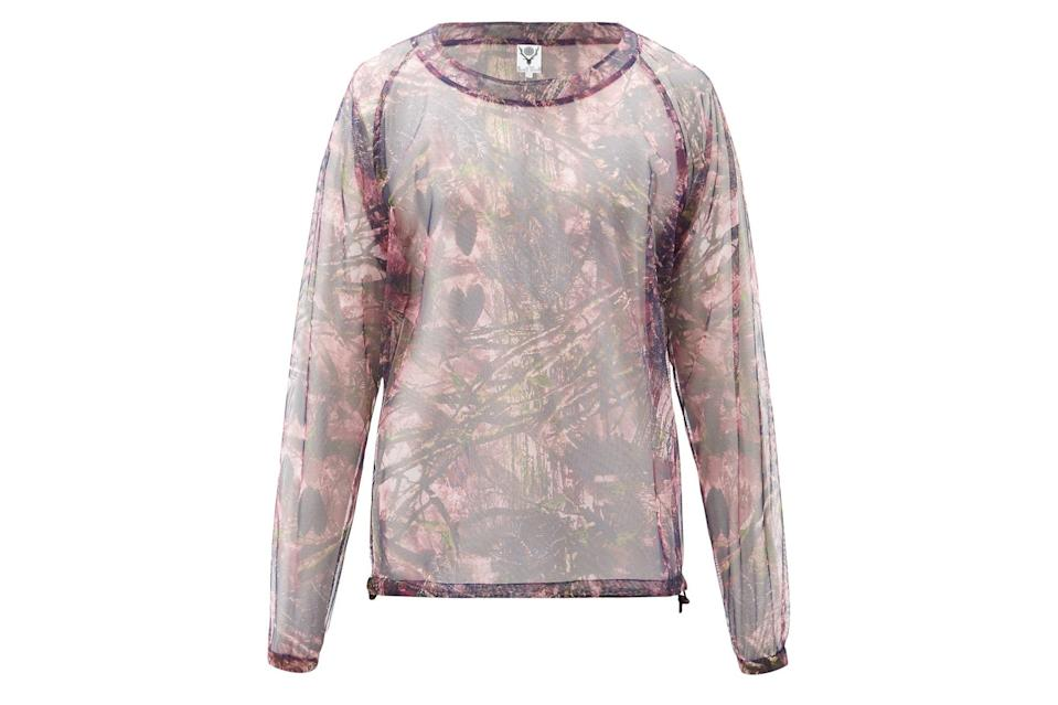 """<p>It's designed to keep the bugs at bay in the backwoods, but <em>boy</em> will it look fly at the beach with nothing underneath.</p> <p><em>South2 West8 bush foliage-print mesh long-sleeved T-shirt</em></p> $314, Matches Fashion. <a href=""""https://www.matchesfashion.com/us/products/South2-West8-Bush-foliage-print-mesh-long-sleeved-T-shirt-1403701"""" rel=""""nofollow noopener"""" target=""""_blank"""" data-ylk=""""slk:Get it now!"""" class=""""link rapid-noclick-resp"""">Get it now!</a>"""