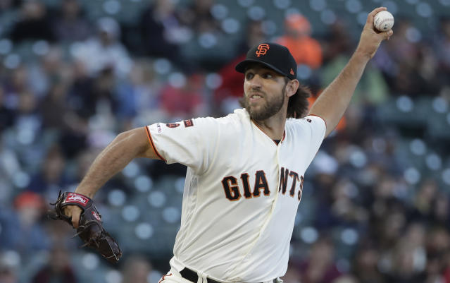 San Francisco Giants pitcher Madison Bumgarner throws to a Colorado Rockies batter during the first inning of a baseball game in San Francisco, Tuesday, June 25, 2019. (AP Photo/Jeff Chiu)