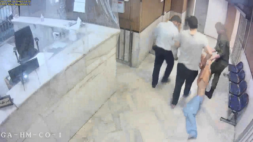 """In this undated frame grab taken from video shared with The Associated Press by a self-identified hacker group called """"The Justice of Ali,"""" guards drag an emaciated prisoner, at Evin prison in Tehran, Iran. The alleged hackers said the release of the footage was an effort to show the grim conditions at the prison, known for holding political prisoners and those with ties abroad who are often used as bargaining chips in negotiations with the West. (The Justice of Ali via AP)"""