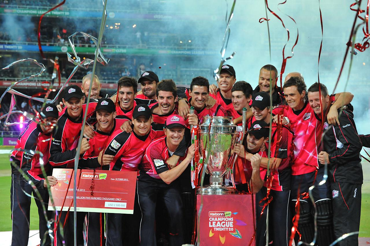 JOHANNESBURG, SOUTH AFRICA - OCTOBER 28: (SOUTH AFRICA OUT) The Sydney Sixers celebrate with the trophy after winning the Karbonn Smart CLT20 Final match between bizhub Highveld Lions and Sydney Sixers at Bidvest Wanderers Stadium on October 28, 2012 in Johannesburg, South Africa. (Photo by Duif du Toit/Gallo Images/Getty Images)