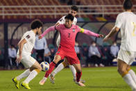 South Korea's Son Heung-min fights for the ball with Syria's Amr Almidani, left, during the final round of the Asian zone group A qualifying soccer match for the FIFA World Cup Qatar 2022 at Ansan Wa Stadium in Ansan, South Korea, Thursday, Oct. 7, 2021. (AP Photo/Ahn Young-joon)