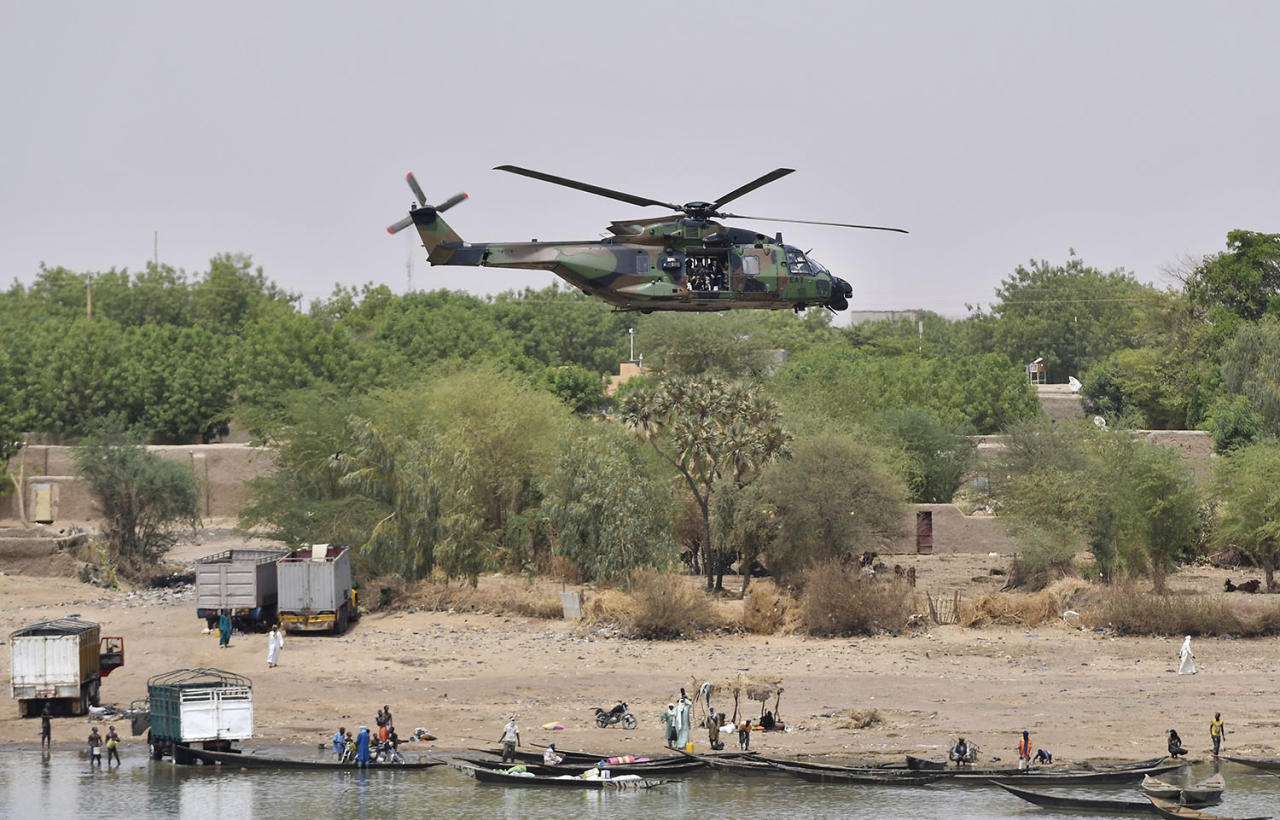 <p>French President Emmanuel Macron flies over Gao in a military helicopter as he visits the troops of Operation Barkhane, France's largest overseas military operation, in Gao, northern Mali, Friday, May 19, 2017. (Christophe Petit Tesson, Pool via AP) </p>