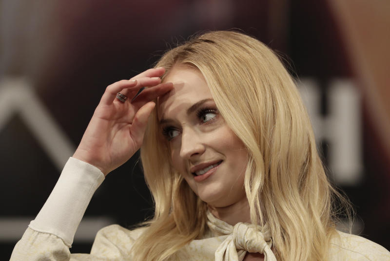 """Actress Sophie Turner attends at a press conference for her new movie """"X-Men: Dark Phoenix"""" in Seoul, South Korea, Monday, May 27, 2019. The movie is to be released in South Korea on June 5, 2019. (AP Photo/Lee Jin-man)"""