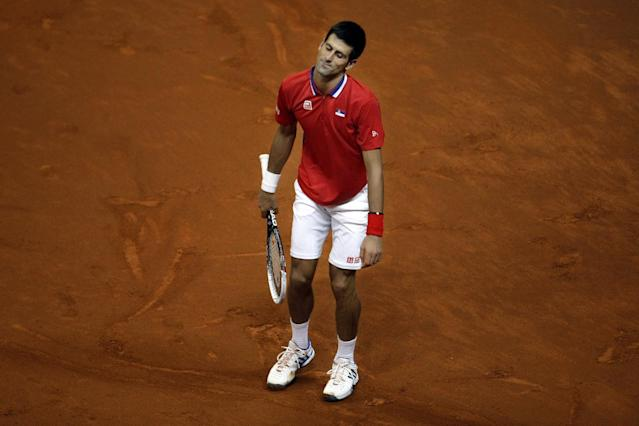 Serbia's Novak Djokovic grimaces after losing a point against Canada's Milos Raonic during their Davis Cup semifinals tennis match in Belgrade, Serbia, Sunday, Sept. 15, 2013. (AP Photo/ Marko Drobnjakovic)