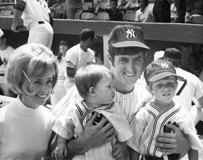 BRONX, NY - AUGUST 7: Pitcher Fritz Peterson #19 of the New York Yankees with his wife and children, Marilyn, Eric, one, and Greg, four, during Family Day at Yankee Stadium on August 7, 1971 in the Bronx, New York. (Photo by Louis Requena/MLB via Getty Images)