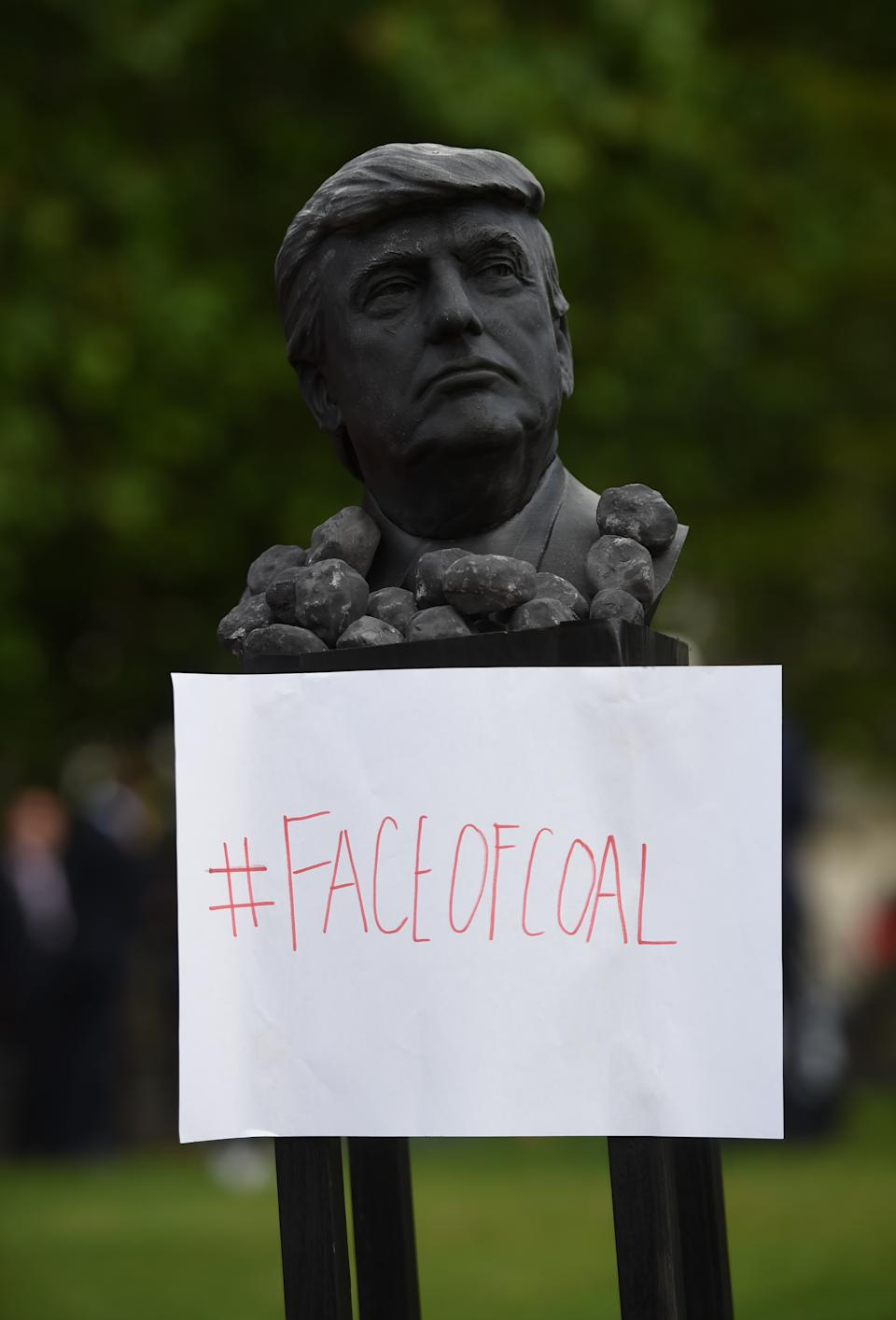 A Trump bust with protestors outside Buckingham Palace, London, during the first day of a state visit to the UK by US President Donald Trump.