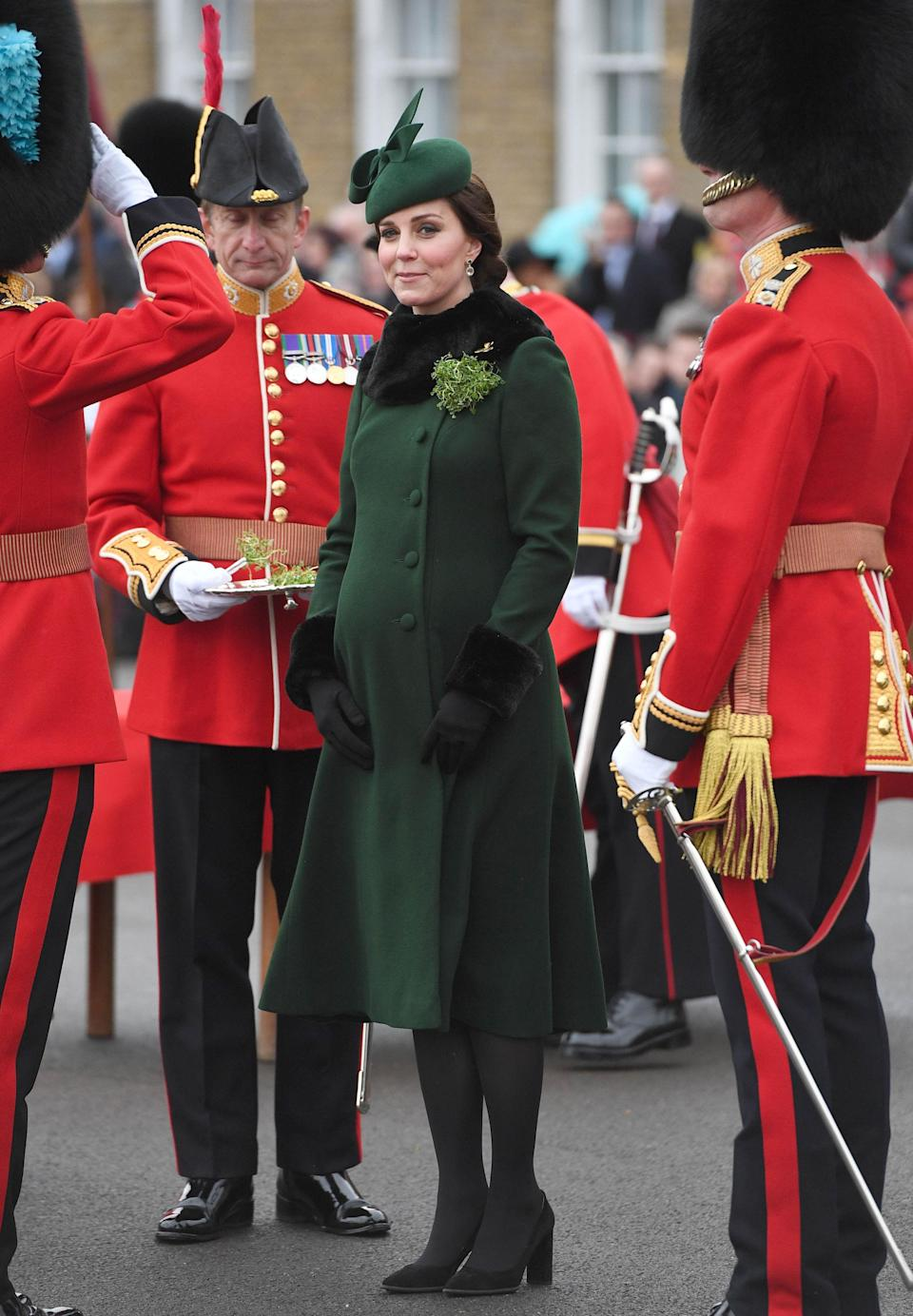 <p>Kate, who was eight months pregnant with Prince Louis, rewore her green Catherine Walker coat from her Norway and Sweden tour, with a matching Gina Foster bow trim hat. She teamed it with her Tod's Suede pumps and her special edition Kiki McDonough green tourmaline, green amethyst and diamond earrings. <em>[Photo: PA]</em> </p>