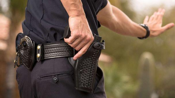 PHOTO: A Policeman preparing to draw his gun in a stock photo. (STOCK PHOTO/Getty Images)