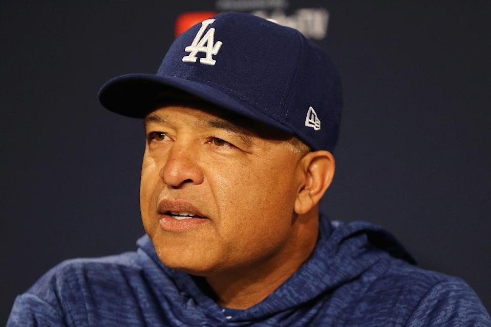 Los Angeles Dodgers manager Dave Roberts, whose team opens the World Series on Tuesday, hopes to see more minorities receive Major League Baseball job opportunities (AFP Photo/Maddie Meyer)