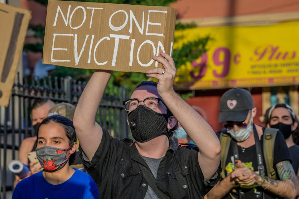 A participant holding a Not One Eviction sign at the protest. Tenants and Housing Activists dropped banners from their buildings and organized a march in the streets of Bushwick demanding the city to cancel rent immediately as the financial situation for many New Yorkers remains the same, strapped for cash and out of work. (Photo: Erik McGregor/LightRocket via Getty Images)