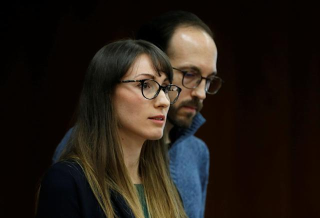 Melissa Vigogne gives a victim impact statement as her husband stands next to her during the sentencing hearing of Larry Nassar, a former team USA Gymnastics doctor who pleaded guilty in November 2017 to sexual assault charges, in the Eaton County Court in Charlotte, Michigan, U.S., February 2, 2018. REUTERS/Rebecca Cook