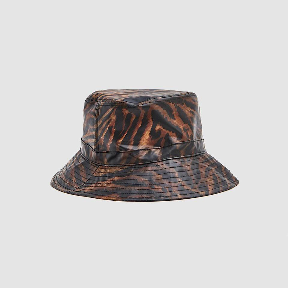 """<p>Since this hat is designed with built-in drawstrings, you never have to worry about it accidentally flying off. It's also made with biodegradable material that fades over time to give it a cool, worn-in look the more you wear it.</p> <p><strong>Buy it:</strong> $80, <a href=""""https://needsupply.com/biodegradable-bucket-hat-in-tiger.html"""" rel=""""nofollow"""">needsupply.com</a></p>"""