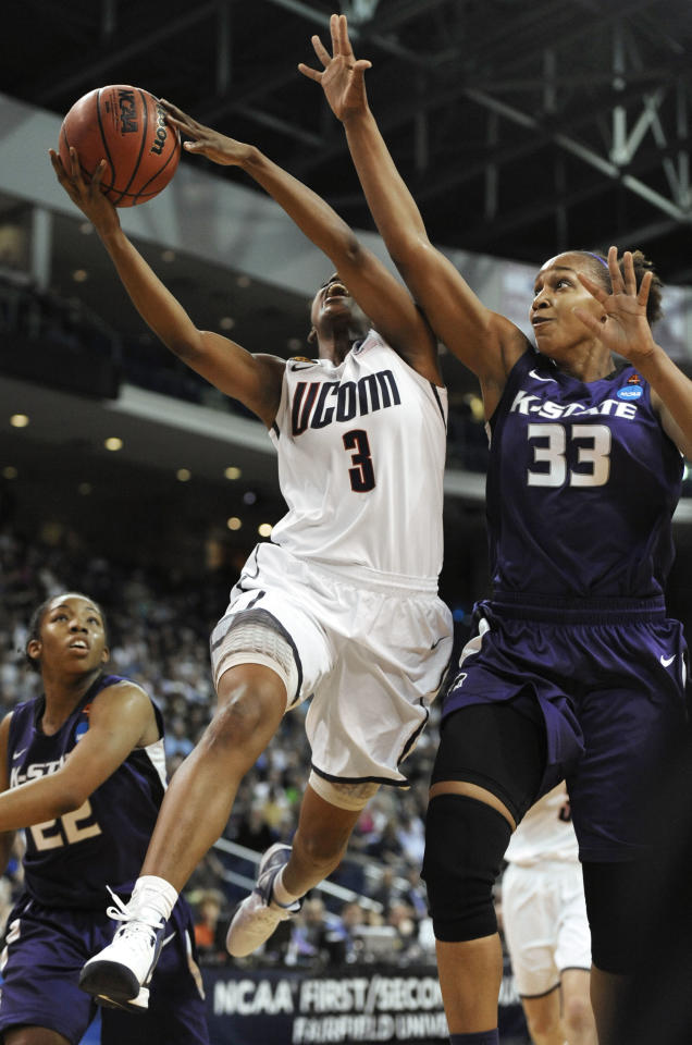 Kansas State's Jalana Childs (33) fouls Connecticut's Tiffany Hayes during the first half of an NCAA tournament second-round college basketball game in Bridgeport, Conn., Monday, March 19, 2012. (AP Photo/Jessica Hill)