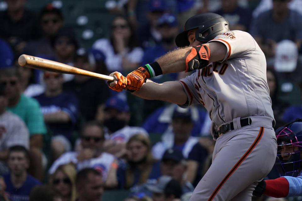 San Francisco Giants' Evan Longoria hits a sacrifice fly during the eighth inning of a baseball game against the Chicago Cubs in Chicago, Friday, Sept. 10, 2021. (AP Photo/Nam Y. Huh)