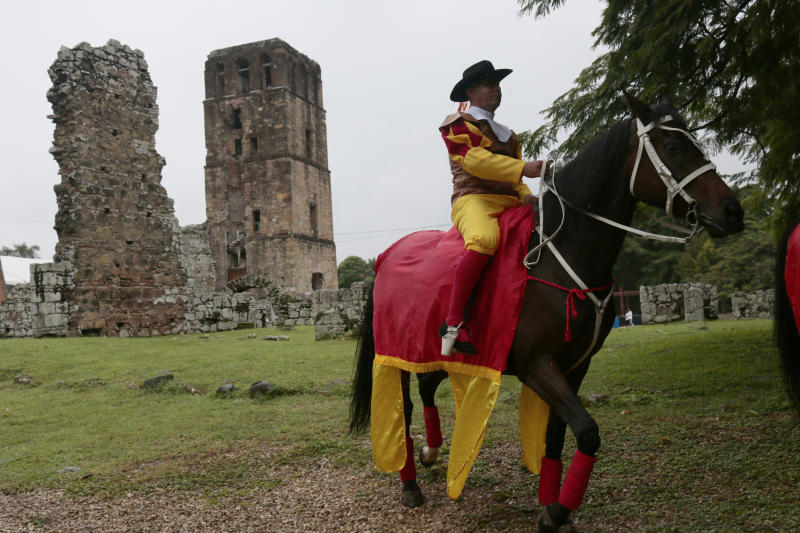A man dressed as old colonial Spaniard rides a horse during the activities celebrating the 500 anniversary of the founding of Panama City, at the site of the ruins of Old Panama, Thursday, Aug. 15, 2019. The city was founded on August 15, 1519, by Spanish conquistador Pedro Arias Davila. On Jan. 28 1671, the Welsh pirate Henry Morgan attacked the city and destroyed it. The attack caused the city to be rebuilt a few kilometers to the west on a new site. (AP Photo/Eric Batista)