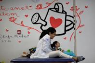 Luana Vieira, who is two years old, and was born with microcephaly, reacts to stimulus during an evaluation session with a physiotherapist at the Altino Ventura rehabilitation center in Recife, Brazil, August 6, 2018. REUTERS/Ueslei Marcelino/Files