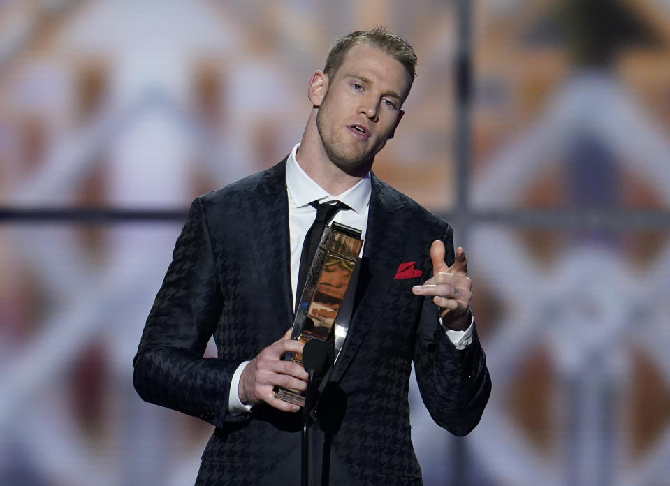 AP Comeback Player of the Year, Tennessee Titans' Ryan Tannehill speaks at the NFL Honors football award show Saturday, Feb. 1, 2020, in Miami. (AP Photo/David J. Phillip)