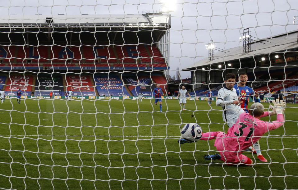 Chelsea's Christian Pulisic scores his side's fourth goal during the English Premier League soccer match between Crystal Palace and Chelsea at Selhurst Park stadium in London, Saturday, April 10, 2021. (Peter Cziborra/Pool via AP)