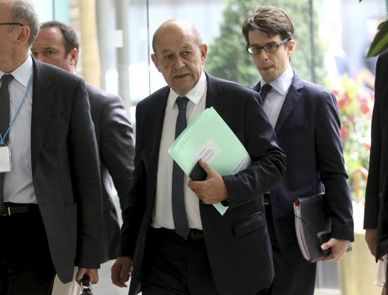 French Foreign Minister Jean-Yves Le Drian, center, arrives for a bilateral meeting as part of the closed-door nuclear talks with Iran at a hotel in Vienna, Austria, Friday, July 6, 2018. (AP Photo/Ronald Zak)