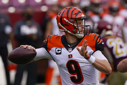 Cincinnati Bengals quarterback Joe Burrow (9) throwing the ball during the first half of an NFL football game against the Washington Football Team, Sunday, Nov. 22, 2020, in Landover. (AP Photo/Susan Walsh)