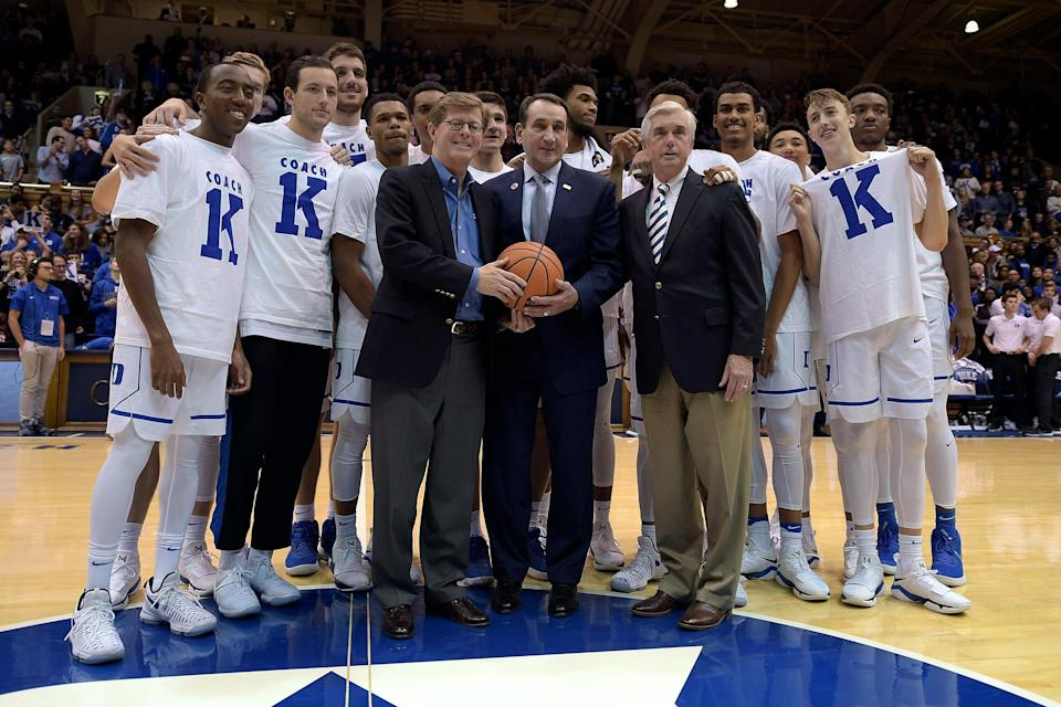 Duke coach Mike Krzyzewski (C) poses for photos with school president Vincent Price (L), athletic director Kevin White (R) and his team following Krzyzewski's 1,000th victory on Nov. 11, 2017. (Lance King/Getty)