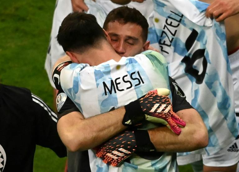 Lionel Messi celebrates with goalkeeeper Emiliano Martinez whose three penalty shoot-out saves sent Argentina into the Copa America final