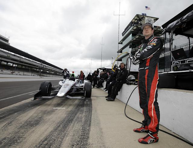 Kurt Busch waits in the pits during practice for the Indianapolis 500 IndyCar auto race at the Indianapolis Motor Speedway in Indianapolis, Thursday, May 15, 2014. On Memorial Day weekend, NASCAR's bad boy is trying to own the title of baddest man on the track by pulling off racing's version of an IronMan triathlon. In a single day, he'll try and race in the Indianapolis 500 and the Coca-Cola 600, with a race or two against the clock thrown in. (AP Photo/Darron Cummings)