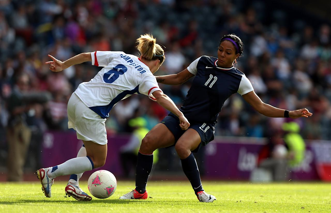 GLASGOW, SCOTLAND - JULY 25:  Sydney Leroux of USA challenges Sonia Bompastor of France during the Women's Football first round Group G Match of the London 2012 Olympic Games between United States and France, at Hampden Park on July 25, 2012 in Glasgow, Scotland.   (Photo by Stanley Chou/Getty Images)