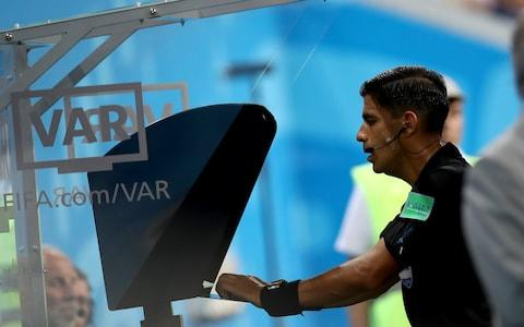 SARANSK, RUSSIA - JUNE 25: Referee Enrique Caceres reviews the VAR footage before awarding Portugal a penalty during the 2018 FIFA World Cup Russia group B match between Iran and Portugal at Mordovia Arena on June 25, 2018 in Saransk, Russia - Credit: Getty Images