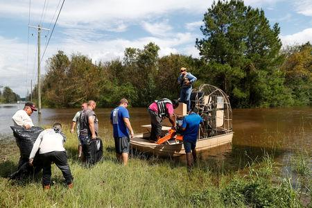 FILE PHOTO: Members of the Cajun Navy transport loggers to clear power lines after Tropical Storm Florence caused a massive flooding in Whiteville, North Carolina, U.S. September 17, 2018.  REUTERS/Randall Hill