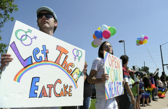Engaged gay couple Charlie Craig and David Mullins were joined by supporters in Lakewood, Colo., in 2012 to protest Masterpiece Cakeshop. (Photo: Kathryn Scott Osler/The Denver Post via Getty Images)