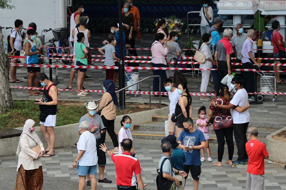 People wait in queue to buy durian on 24 June. (PHOTO: Getty Images)