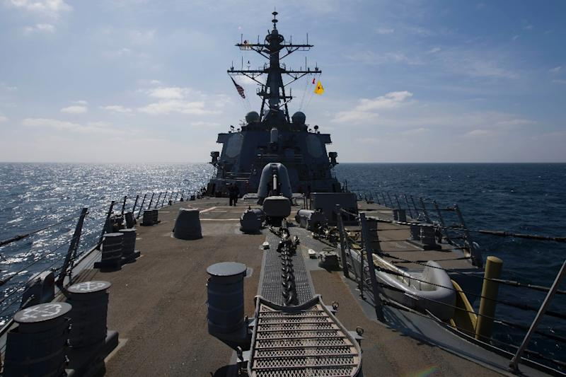 This US Navy photo obtained February 3, 2017 shows the Arleigh Burke-class guided-missile destroyer USS Cole (DDG 67) as it flies the National Ensign and the 4th Marine Division (MARDIV) flag on January 16, 2017
