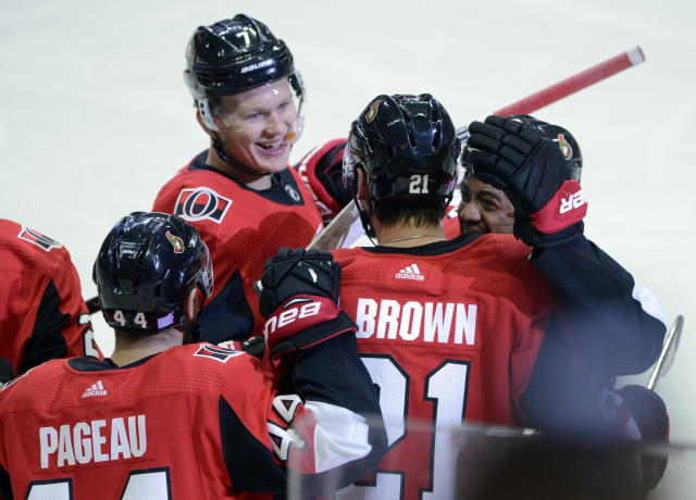 Ottawa Senators center Logan Brown (21) celebrates his first NHL goal, with teammates Jean-Gabriel Pageau and Brady Tkachuk (7), as they take on the New York Rangers during the first period of an NHL hockey game Friday, Nov. 22, 2019, in Ottawa, Ontario. (Sean Kilpatrick/The Canadian Press via AP)